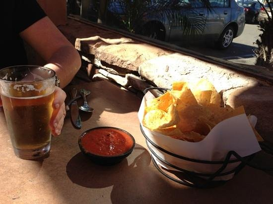 Fat Fish Cantina Grill:                   chips and salsa and mexican beer - yum...just wait til the guac arrives!