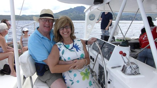 Carnival Sailing Party Cruises:                                     Steering the catamaran