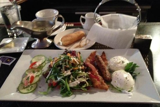 Madison Bistro:                   soft poached eggs, bacon, and sausage w mesculin