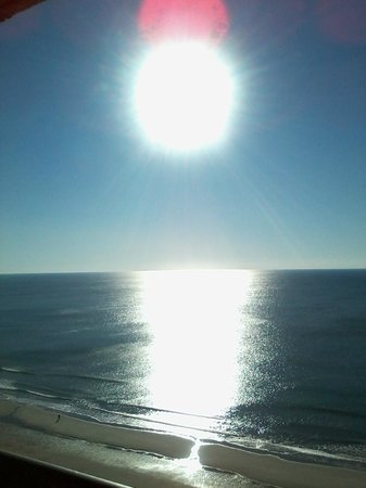 Embassy Suites by Hilton Myrtle Beach-Oceanfront Resort:                   Sun rising over ocean