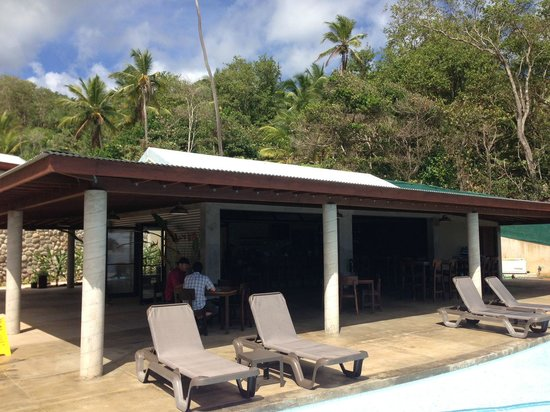 Pagua Bay House Oceanfront Cabanas :                                                                         Dining area and pool