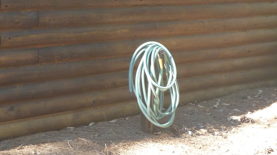The Campsites at Disney's Fort Wilderness Resort:                   garden hose at back of cabin