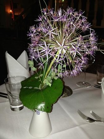Al Dar:                   flower on table
