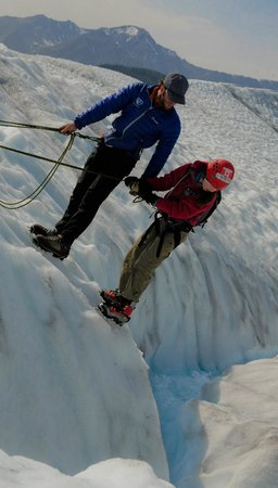"Wild Alpine - Day Tours: ""Top roping"" on the Root Glacier, learning about ice melt looking into a moulin"