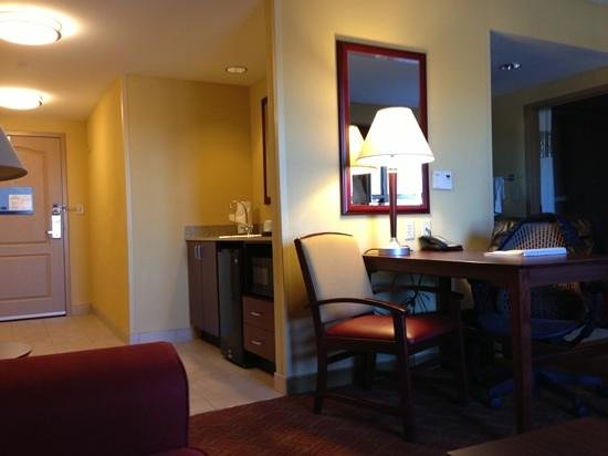 Hampton Inn & Suites Oklahoma City / Bricktown:                                     desk, kitchen area, from couch perspective