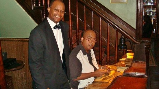 Graycliff Hotel : A well dressed Anthony, the maitre'd, and Raoul, a cigar maker