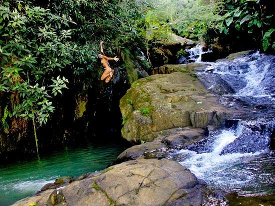 Rainforest Inn: Jumping in our private waterfall pool deep in the rainforest