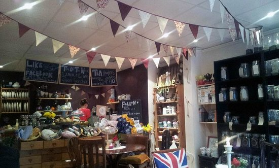 The Olde Young Tea House:                   Bunting decor and the main counter