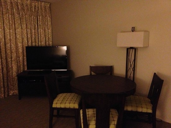 Plantation Hale Suites:                   living room is large...this is just a corner...two flat screens on in the bedr