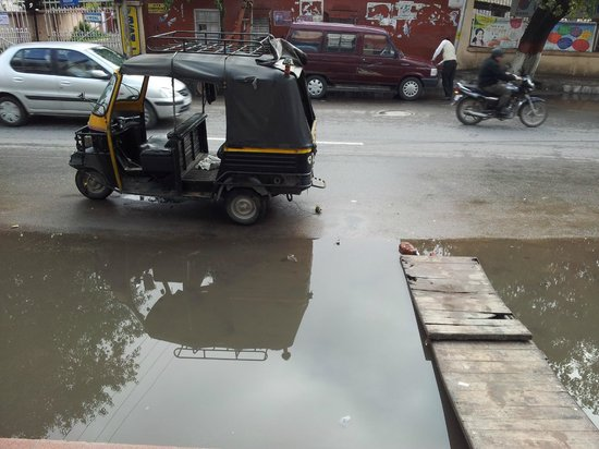 Aay Kay Hotel:                   Water flooded in front of hotel during rainy day