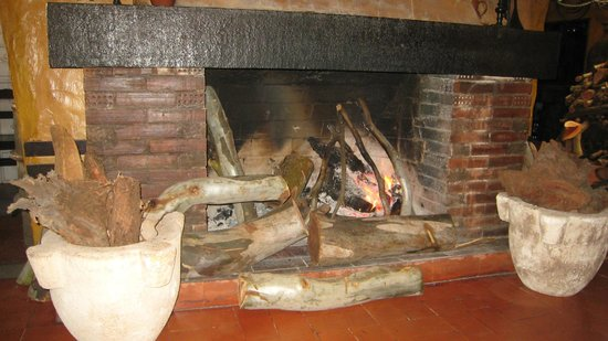 Casa Martell :                   A warm and welcomming fireplace next to our table.