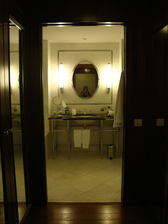 The Westin Valencia:                   A huge bathroom with a bath and walk-in shower, closets line the entrance hall