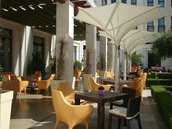 The Westin Valencia:                   Tables and chairs outside the bar