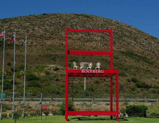 a chair to climb up - at the entrance of Bodega de Vinho