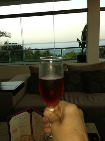 El Dorado Casitas Royale, by Karisma:                   Enjoying a Bellini at Bellini's Bar overlooking the ocean!