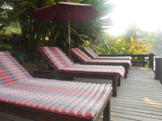 Oriental Kwai Resort:                   Sunloungers by the river