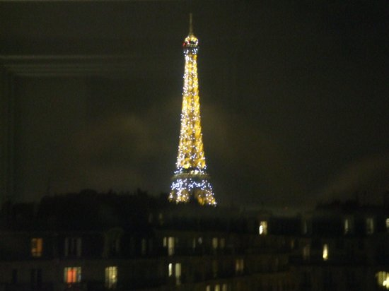 First Hotel:                   The Eiffel Tower at night (from our room)