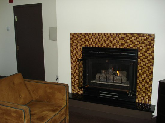 Magnolia Hotel Denver:                   Gas fireplace in sitting room