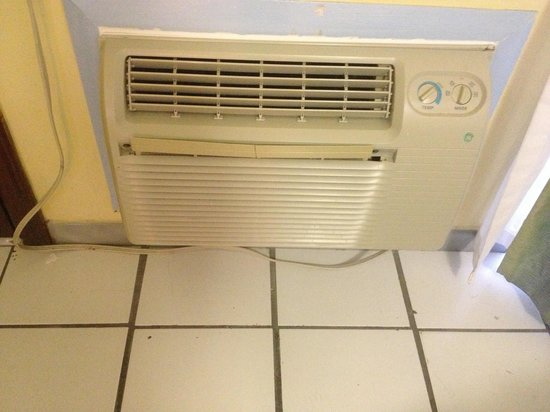 Flamingo Bay Hotel & Marina:                                                       Air conditioner and tile