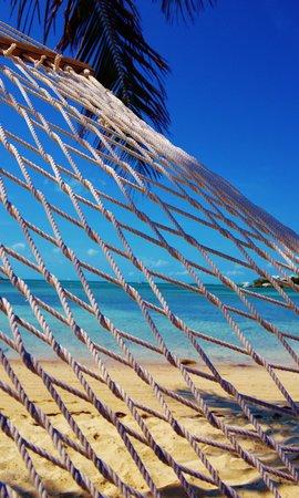 Oceanfrontier Hideaway:                   Sitting in a hammock @ Grabber's