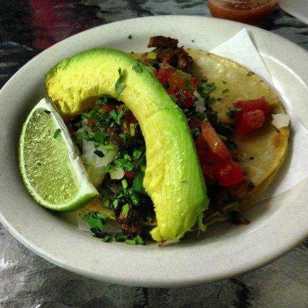 Alegria Tacos :                   el pastor taco served with a fresh slice of avocado