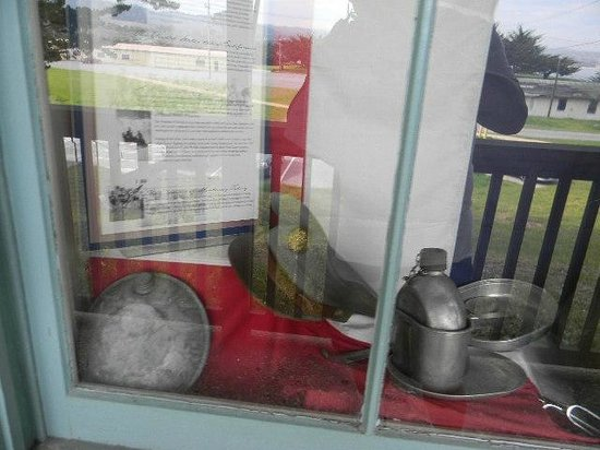 Presidio Museum:                                     Front window with canteen and other pack items