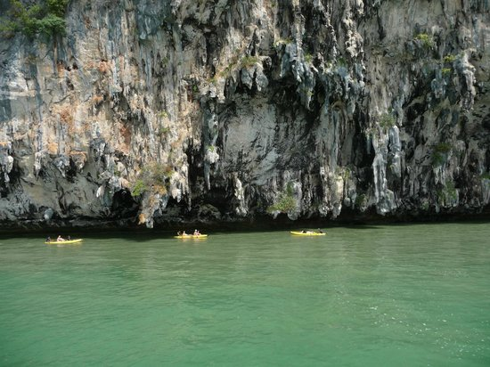 John Gray's Sea Canoe:                   Canoes with 2 passengers and a guide about to enter a cave
