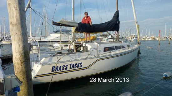 Nautical Nook Bed and Breakfast :                   Keith packing Brass Tacks away after an evening sail