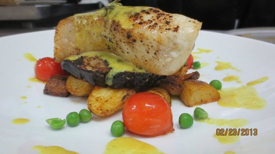 Yolo | Fusion Cuisine and Sushi Lounge:                                     Sea Bass vanilla saffron sauce