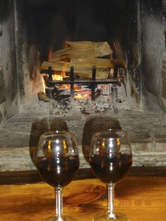 Lake Placid Lodge:                                     sipping wine in front of the fire