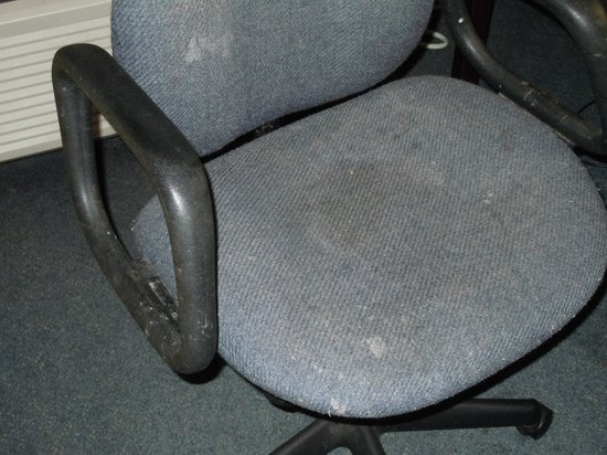 Quality Inn Murfreesboro:                                     Desk chair with stains and worn.