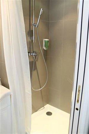 New Orient Hotel:                   Fun shower, good water pressure and hot water