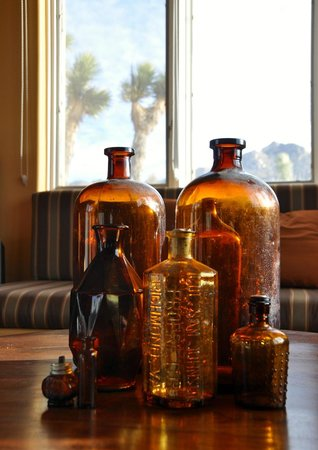 "Desert Lily:                                     Charming touches like this collection of ""found"" bottles on"