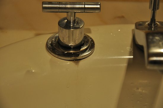 Le Chamois:                                                       Leaking tap in bathroom, the tap in the ki