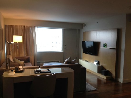 The James Hotel:                   Suite- Living room with TV