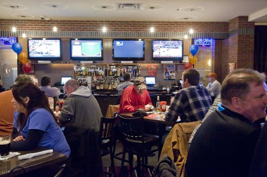 Coaches Sports Bar & Grill : Coaches offers 12 HD TVs that are sure to be playing your favorite team's big game.