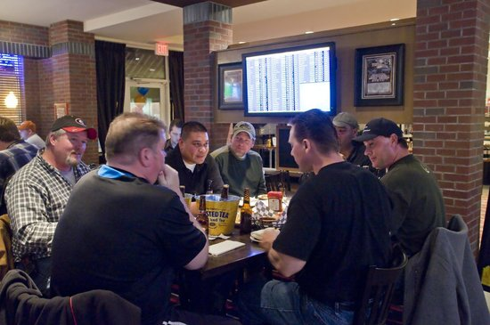 Coaches Sports Bar & Grill : Hold your fantasy draft party here while you watch the latest news on ESPN.