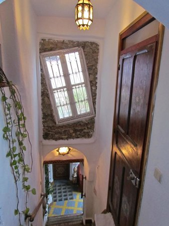 Dar Meziana Hotel:                                     Stairwell with Crazy Window