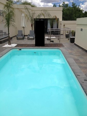 Galton House:                   Pool area and one of the larger rooms in the back