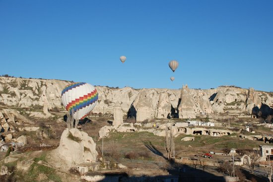SOS Cave Hotel:                   hot air balloons flying in the morning