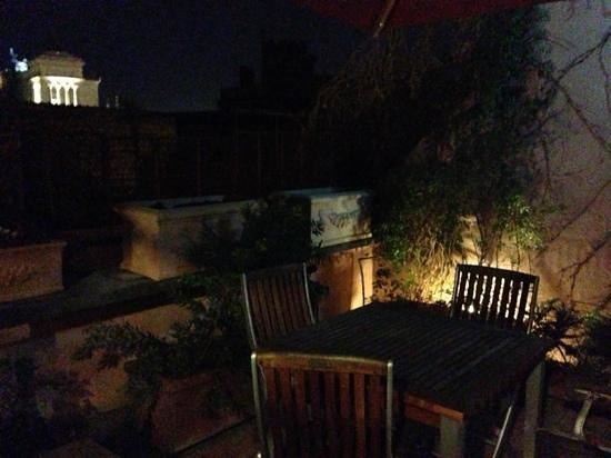 The Inn At The Roman Forum - Small Luxury Hotel:                   roof terrace at night