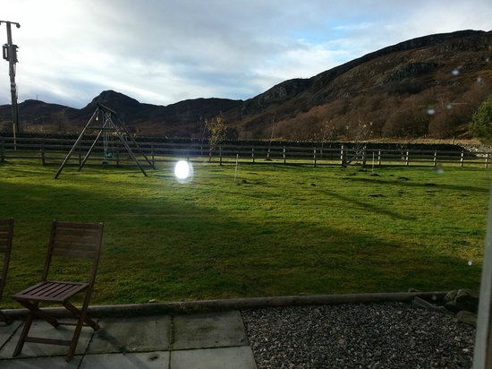 Highland Holiday Cottages:                   View from living room in Ash Cottage (the garden)