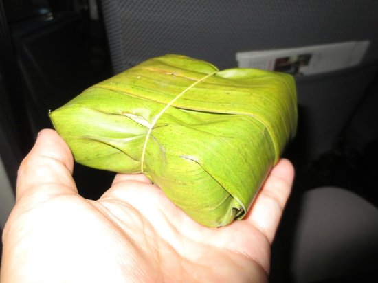 AVANI Quy Nhon Resort & Spa: Boxed breakfast sandwich wrapped in banana leaf