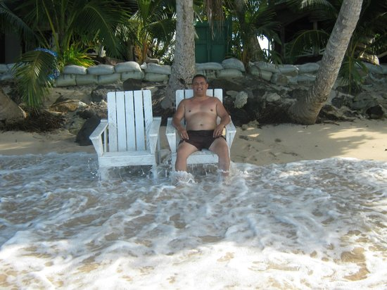 Vacations Beach Fales:                   Hubby enjoying the waves under the tree