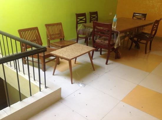 Hotel Satkar:                   dining room with dead bugs on floor.