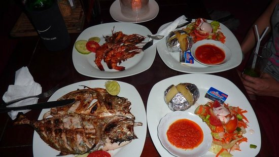 Zipp Bar Restaurant & Bungalows:                   Delicious Fish and Prawns BBQ served with veggies and potatoes/rice