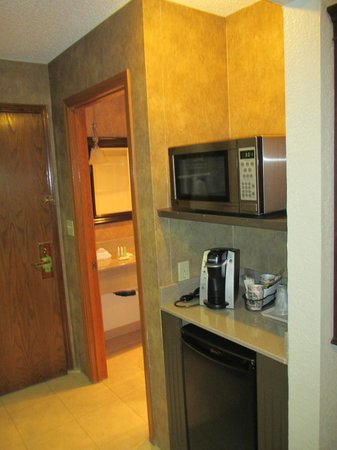Quality Inn & Suites Kansas City Airport North:                                     Microwave, coffee maker, and fridge in room.