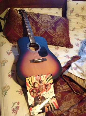 House of the Rising Sun Bed and Breakfast :                                     The guitar and the offbeat magazine ready on the bed