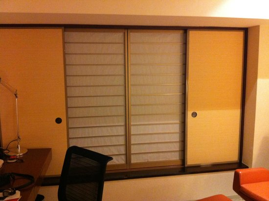 Hilton Tokyo:                   Instead of curtains, you get this japanese sliding windows
