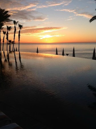 Hilton Los Cabos Beach & Golf Resort:                   Sunrise over the infinity pool and the Sea of Cortez